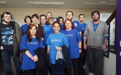"Decorator Volunteers from Nielsen at the <span class=""brandword black"">in</span><span class=""brandword teal"">vol</span><span class=""brandword black"">ve</span> Offices!"